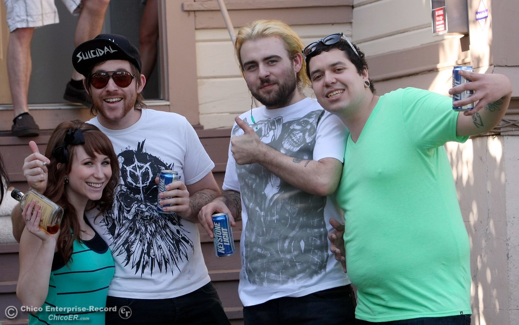 . Partiers pose for the camera along W. 3rd St. near Hazel St. as St. Patrick Day celebrations spill into the streets as partiers, CSUC/Butte students and non-students, enjoy the week off on Wednesday, March 17, 2010 in Downtown Chico, Calif. 