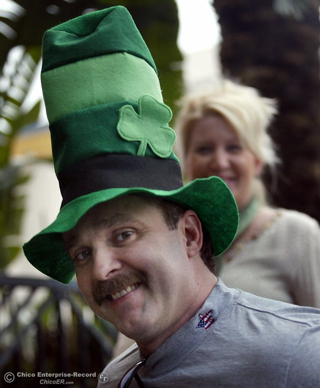 . Steve Kidwell of Chico and his wife Bridi (behind in photo) head downtown for some St. Patricks Day shopping Friday.
