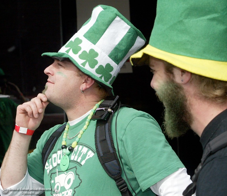 . March 17 2009 in Chico Ca. Downtown Saint Patricks Day. In this picture,Making a play for the camera as he walks down Main street is A.J. Jones while his good friend Nick \'Hacksaw\' Hamilton chuckles at his antics..,(Ty Barbour/Chico Enterprise-Record)