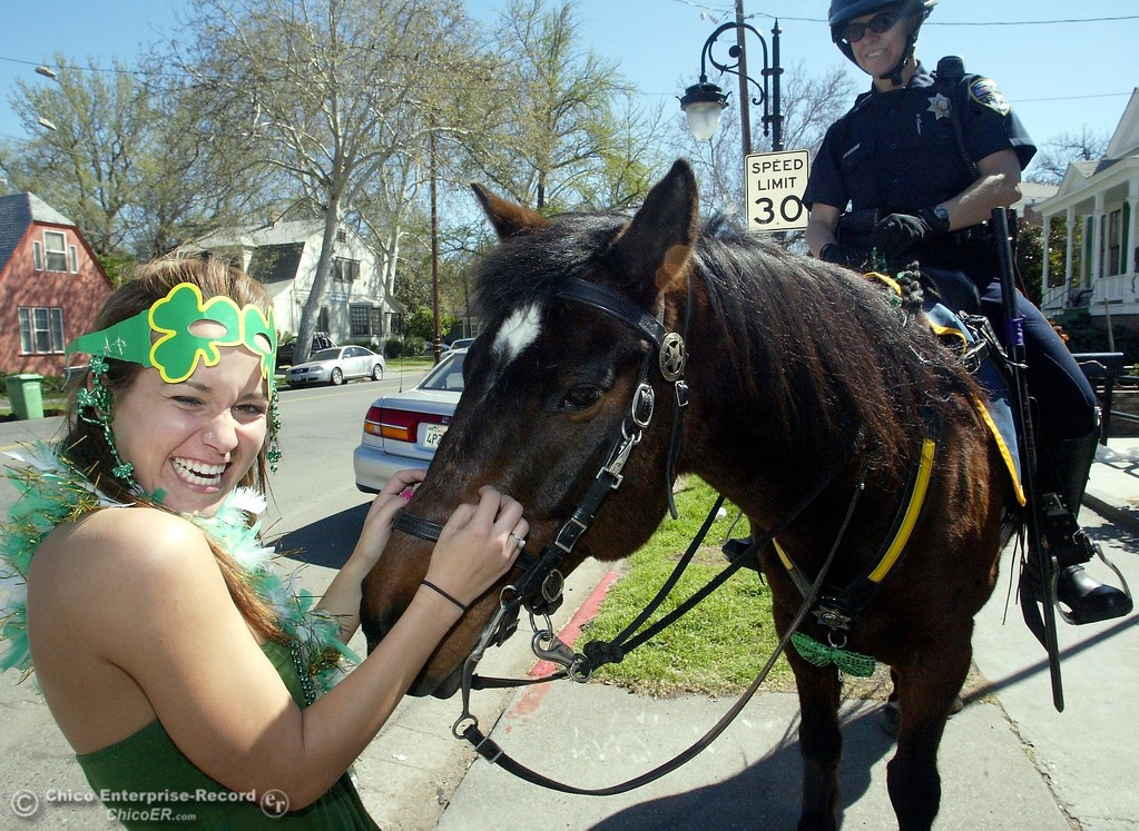 ". Monday March 17, 2008 in Chico, CA. Saint Patricks Day. In this picture,outside a party at 2nd and Ivy street Janette Wason 21 years old and a CSUC student gets a friendly nudge from ""Magic\"" a Chico Police Horse ridden by Officer Abbie Madden.