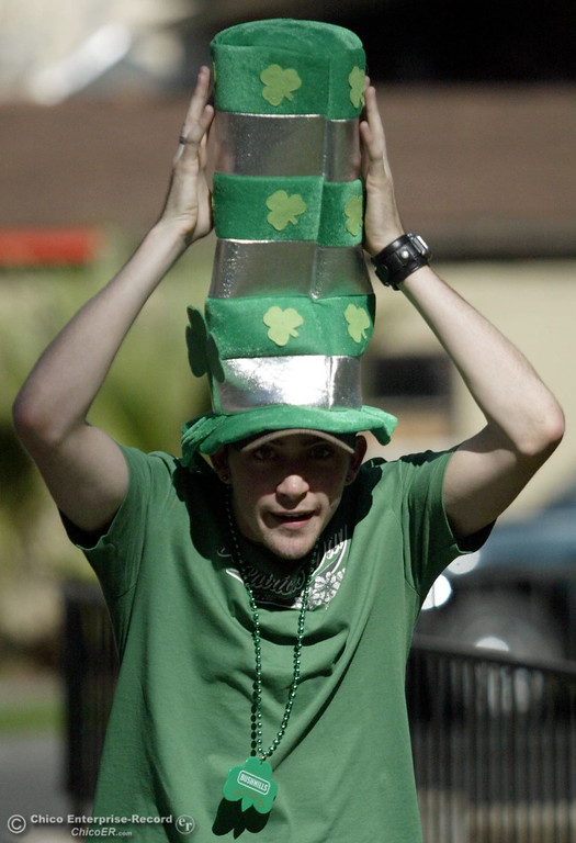 . Nick Johnson, 23, holds his hat up straight as he celebrates St. Patrick\'s Day on Saturday, March 17, 2007 in Chico, CA. 