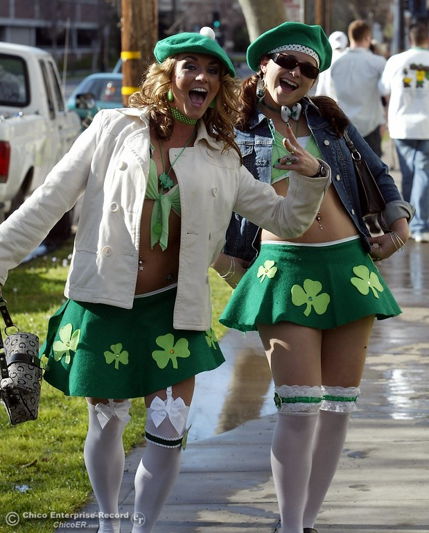 . Two women got all dressed up for the party as they walk along Ivy st. Friday afternoon for St. Patrick\'s Day. - halley photo 3/17/06