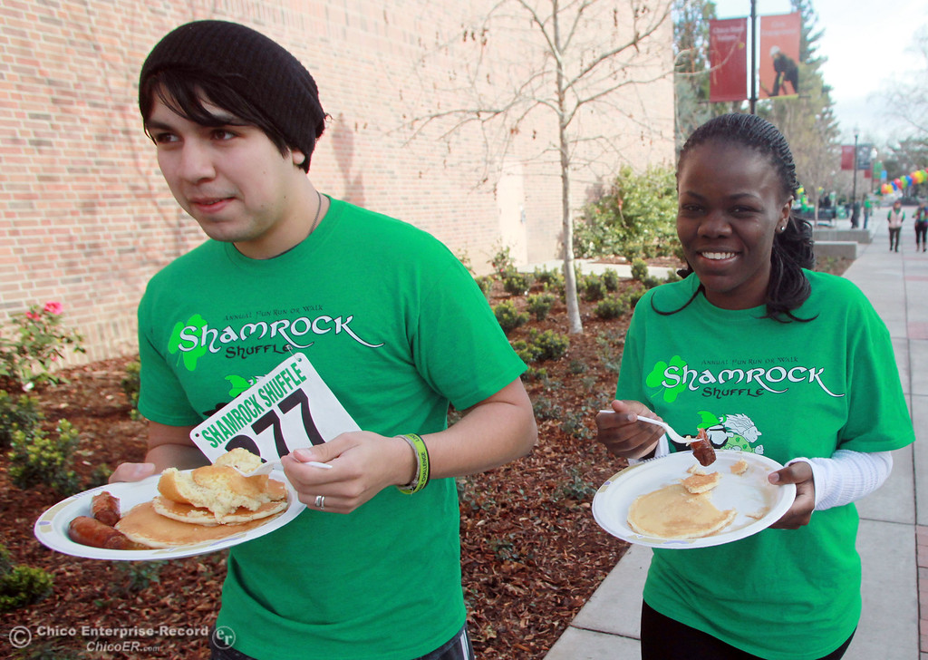 . Michael Uribe (left) and Hortonce Niyigena (right) carried their pancakes in a run/walk in the 11th Annual Shamrock Shuffle for St. Patrick\'s Day festivities on the Chico State campus Saturday, March 17, 2012 in Chico, Calif. 