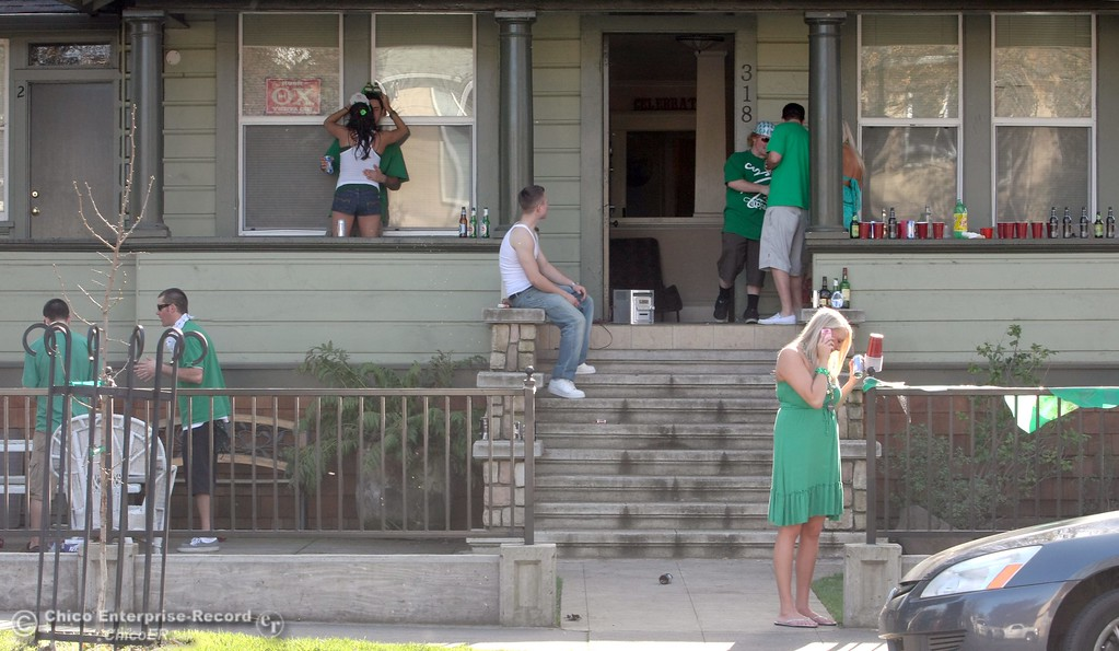 . Partiers hang outside a home along Ivy St. near W. 3rd St. as St. Patrick Day celebrations spill into the streets as partiers, CSUC/Butte students and non-students, enjoy the week off on Wednesday, March 17, 2010 in Downtown Chico, Calif. 