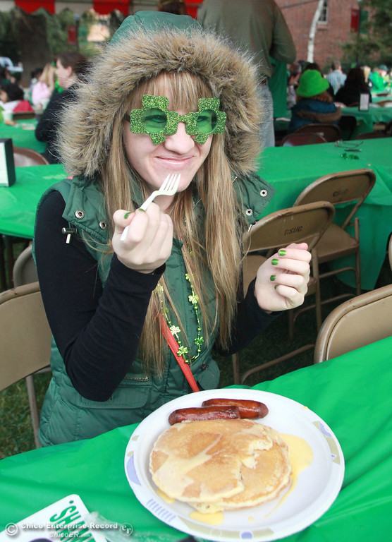 . LIndsay Ashcraft, 21, takes a bite into her pancakes at the 11th Annual Shamrock Shuffle for St. Patrick\'s Day festivities on the Chico State campus Saturday, March 17, 2012 in Chico, Calif. 