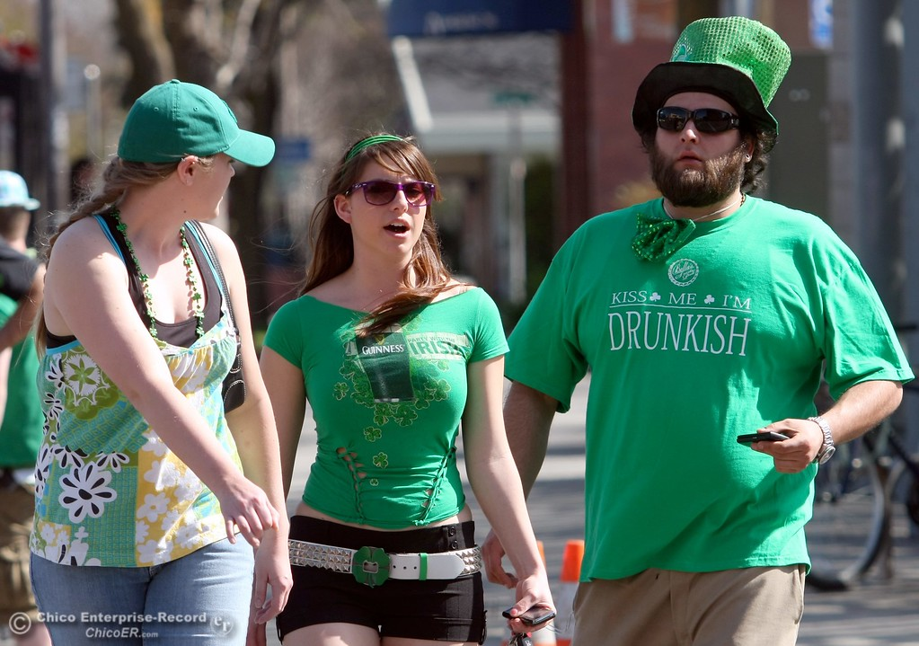 . Laura Stokes, 23, Kristin Panarra, 22, and Harry Carranza, 30, (left to right) walk along Salem St. across W. 2nd St. as St. Patrick Day celebrations spill into the streets as partiers, CSUC/Butte students and non-students, enjoy the week off on Wednesday, March 17, 2010 in Downtown Chico, Calif. 