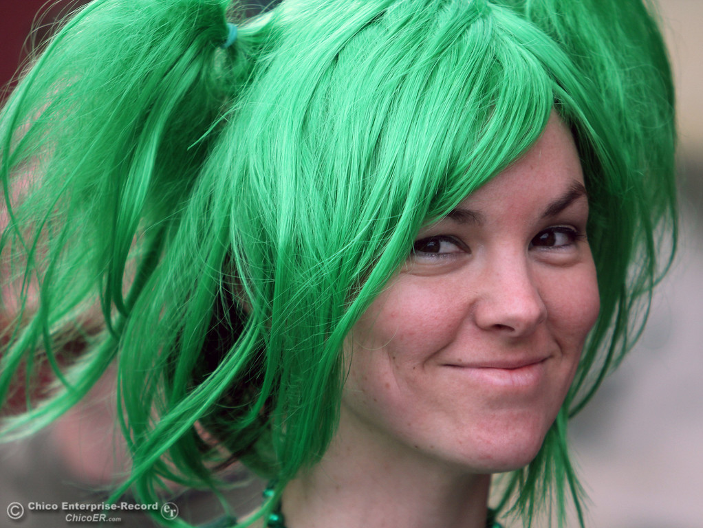 . Butte College student Kristonda Pryor, 27, waits in line at the Madison Bear Garden as people celebrate St. Patrick\'s Day festivities in the south CSUC campus area and Downtown Chico Thursday , March 17, 2011 in Chico, Calif.
