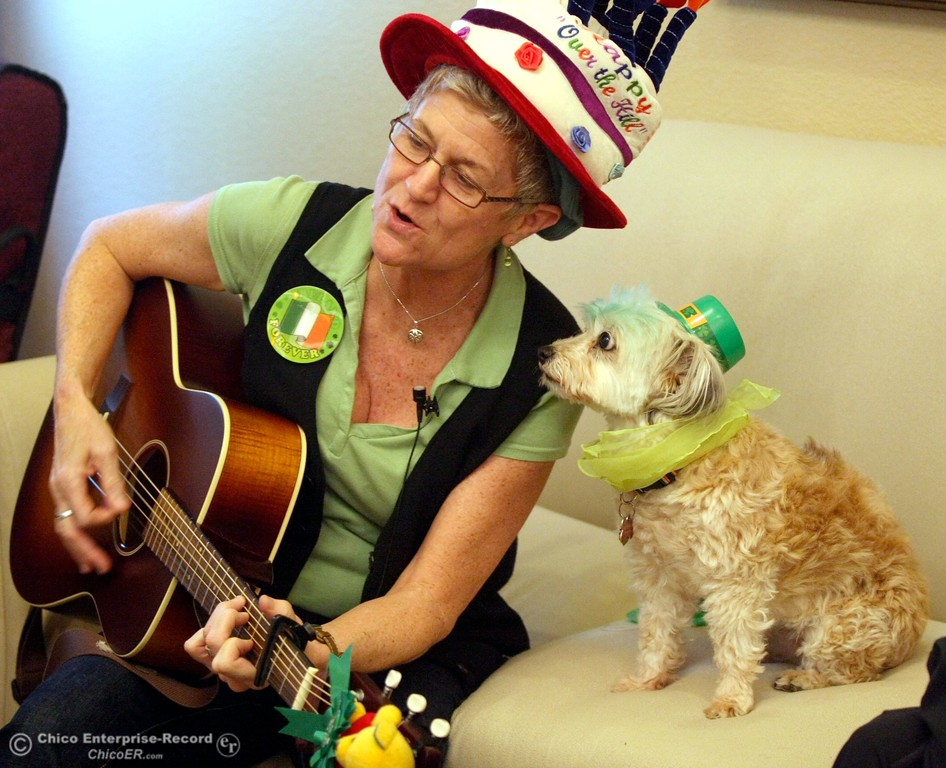 . Roseleaf\'s activity coordinator, Kim Vickers, sings with Jojo, a therapy dog, for the St. Patrick\'s Day and Jojo\'s bday celebration at Roseleaf, an assisted living center, on Wednesday, March 17, 2010 in Chico, Calif. Jojo is a rescue dog believed to be a cross between a Shih Tzu and Maltese. 