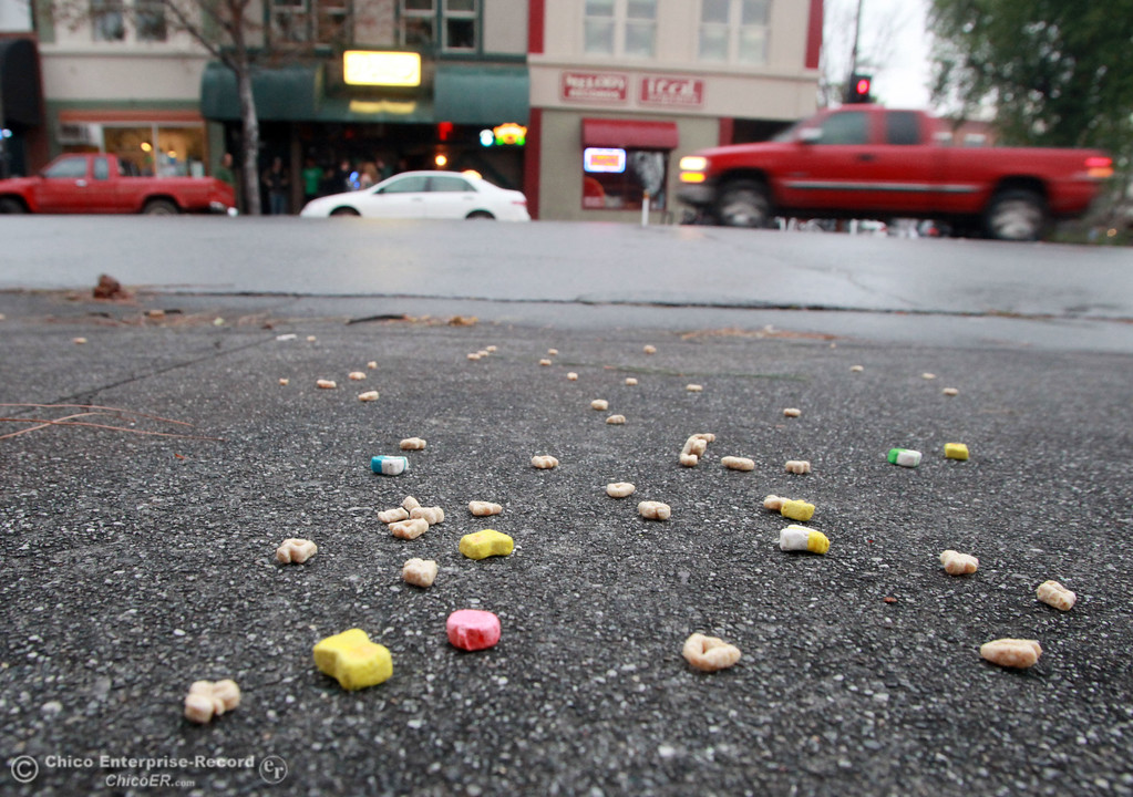 ". Some ""Lucky Charms\"" cereal lies on the ground as people hit the town for something to celebrate during St. Patrick\'s Day Saturday, March 17, 2012 in downtown Chico, Calif. 