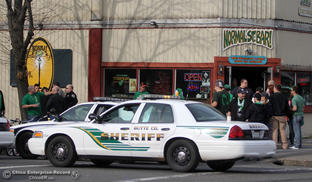 . Butte County Sheriff and Police respond to a fight in front of Normal St. Bar People celebrate St. Patrick\'s Day festivities in the south CSUC campus area and Downtown Chico Thursday , March 17, 2011 in Chico, Calif.