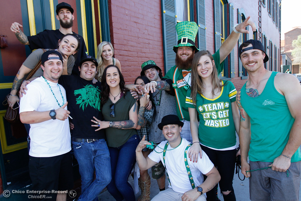. A group of friends pose for a photo as they celebrate St. Patrick Day March 17, 2016 in downtown Chico, Calif. (Emily Bertolino -- Enterprise-Record)