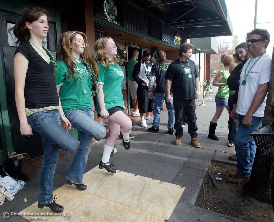 . March 17 2009 in Chico Ca. Downtown Saint Patricks Day. In this picture,outside Duffy\'s, girls from the Oliver Accadmy of Dance do a Irish Jig called a \'reel\' on the sidewalk entertaining passers by. They stopped at a retirement home and other locations around town as they danced the day along. LtoR are,Rose Trulin,Cara Canno,Shannon Sullivan.,(Ty Barbour/Chico Enterprise-Record)