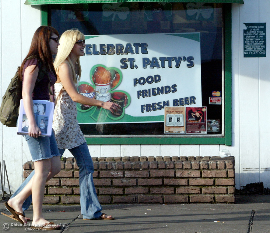. March 13  2007 In Chico Ca. Near the corner of 5th and Ivy streets a sign in a bar window to celebrate St. Patricks Day. In this picture,College coeds walking to class as they pass the sign with seemingly no interest  (Ty Barbour Chico Enterprise-Record)