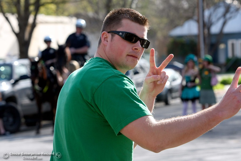 . Partiers walk along Ivy St. near W. 4th St. as St. Patrick Day celebrations spill into the streets as partiers, CSUC/Butte students and non-students, enjoy the week off on Wednesday, March 17, 2010 in Downtown Chico, Calif.  Note: This is Scott Malone. 