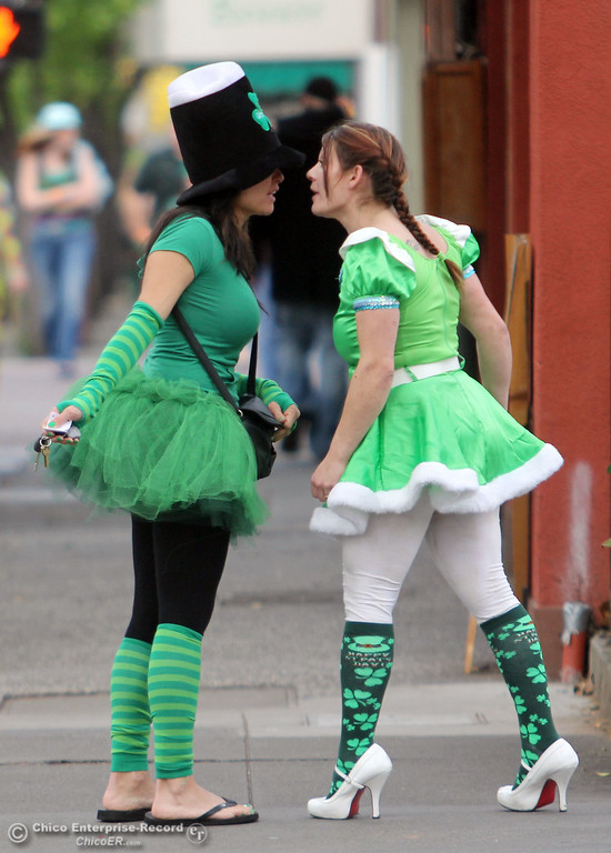 . Two women get into a verbal fight along W. 2nd St. as people celebrate St. Patrick\'s Day festivities in the south CSUC campus area and Downtown Chico Thursday , March 17, 2011 in Chico, Calif.