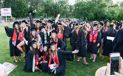 Students pose for a photo before Chico State's graduation ceremony Friday, May 17, 2019, in Chico, California. (Matt Bates -- Enterprise-Record)