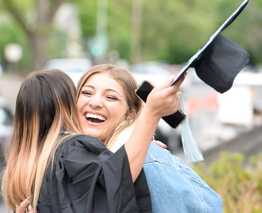 Carlie Reeder smiles as she hugs Bri Bengivengo  before Chico State graduation ceremonies Friday, May 17, 2019, in Chico, California. (Matt Bates -- Enterprise-Record)