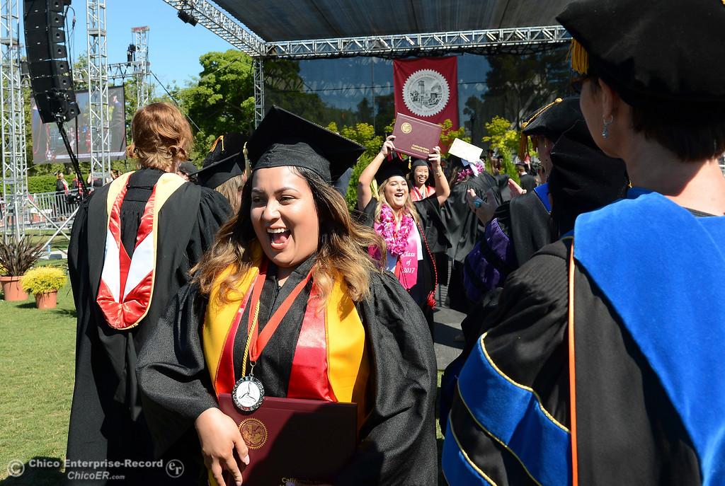 . Miriam Reynoso, front left, and Makayla Confer celebrate as Chico State graduates receive their diplomas Saturday, May 20, 2017, at University Stadium in Chico, California.  (Dan Reidel -- Enterprise-Record)