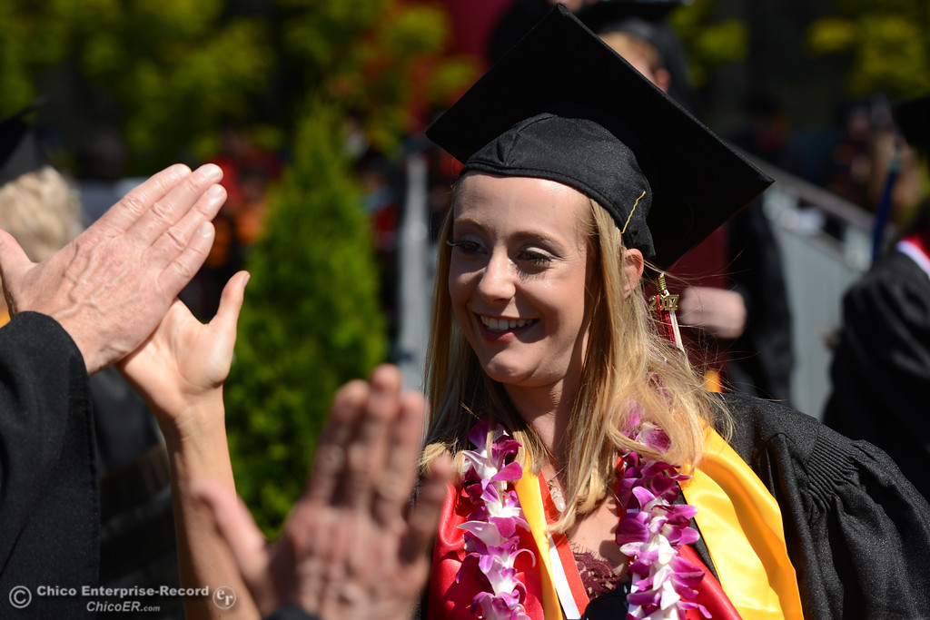 . Kristin Vierra gets high fives from faculty members after receiving her diploma as Chico State seniors graduate Saturday, May 20, 2017, at University Stadium in Chico, California.  (Dan Reidel -- Enterprise-Record)