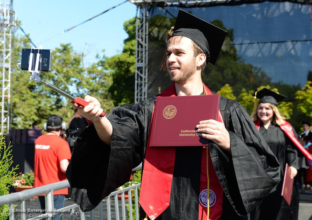 . Nicholas Fabish takes a selfie as Chico State graduates receive their diplomas Saturday, May 20, 2017, at University Stadium in Chico, California.  (Dan Reidel -- Enterprise-Record)