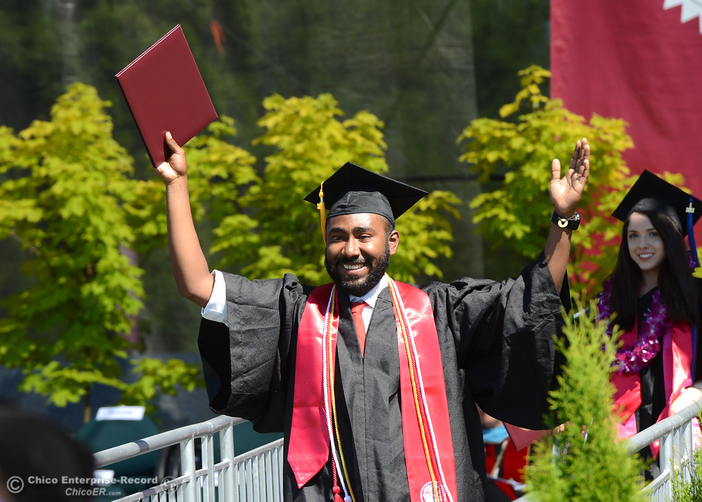 . Freddy Anyakora raises his arms as he walks down the ramp with his diploma Saturday, May 20, 2017, during Chico State\'s commencement ceremony at University Stadium in Chico, California.  (Dan Reidel -- Enterprise-Record)