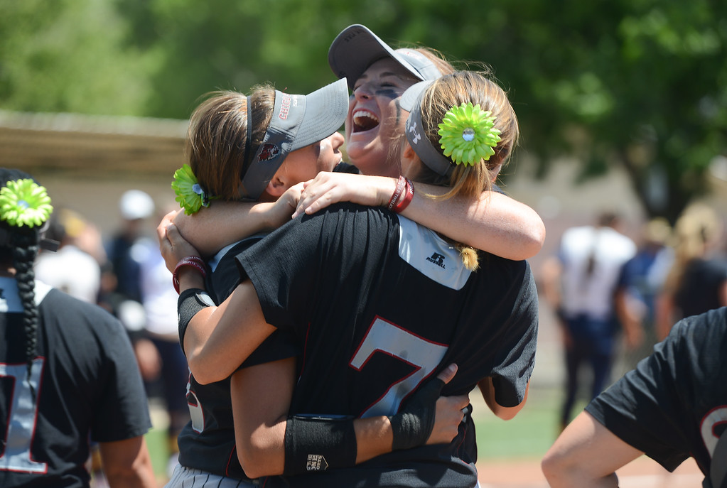 . Chico State\'s Ari Marsh, Sara Mitrano and Annie Weiss hug as they win the NCAA West Regional championship game against Northwest against California Baptist, May 12, 2018,  in Chico, California. (Carin Dorghalli -- Enterprise-Record)
