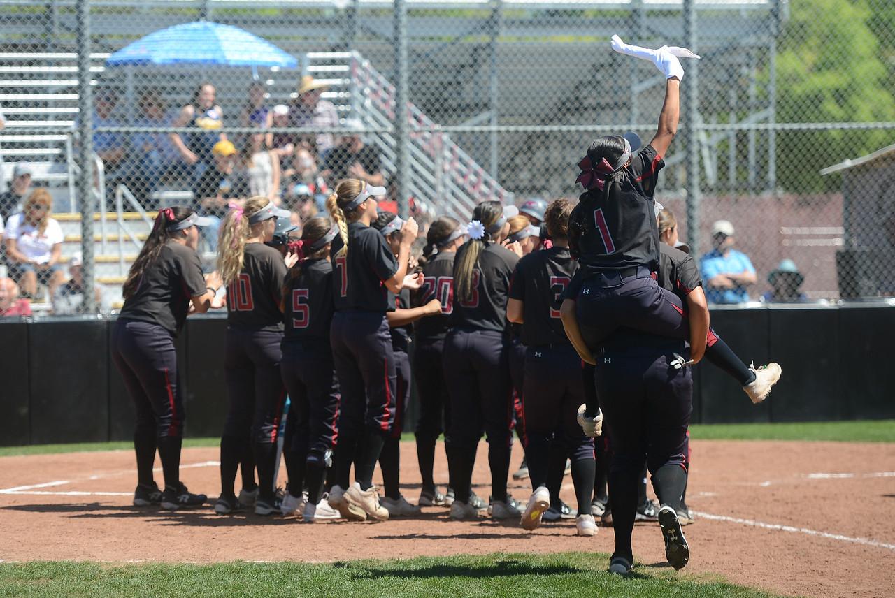 The Chico State softball team runs toward the home base to greet Karli Skowrup after she hit a homerun, April 14, 2018, in Chico, California. (Carin Dorghalli -- Enterprise-Record)