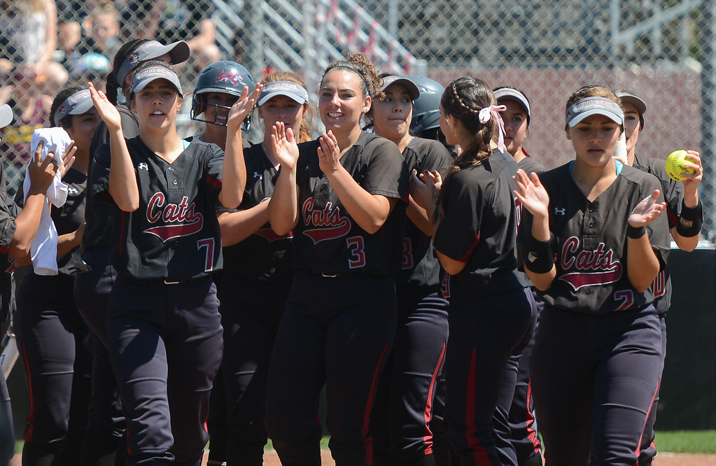 . The Chico State softball team celebrates Karli Skowrup\'s homerun, April 14, 2018, in Chico, California. (Carin Dorghalli -- Enterprise-Record)