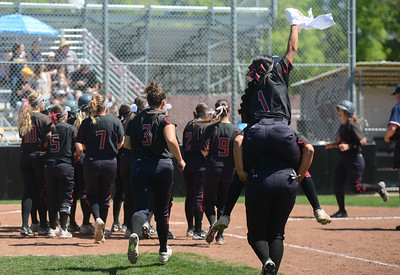 The Chico State softball team runs toward the home base to greet Karli Skowrup after she hit a homerun, April 14, 2018, in Chico, California. (Carin Dorghalli -- Enterprise-Record)