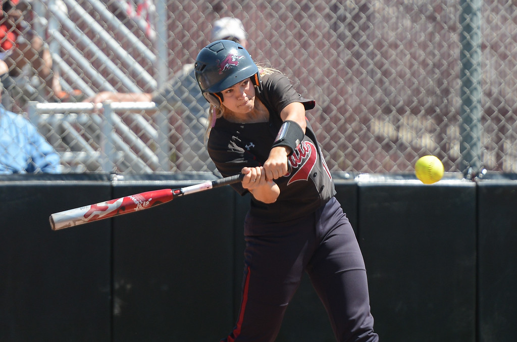 . Chico State\'s Megan Bowley hits the ball during a home game against Sonoma State, April 14, 2018, in Chico, California. (Carin Dorghalli -- Enterprise-Record)