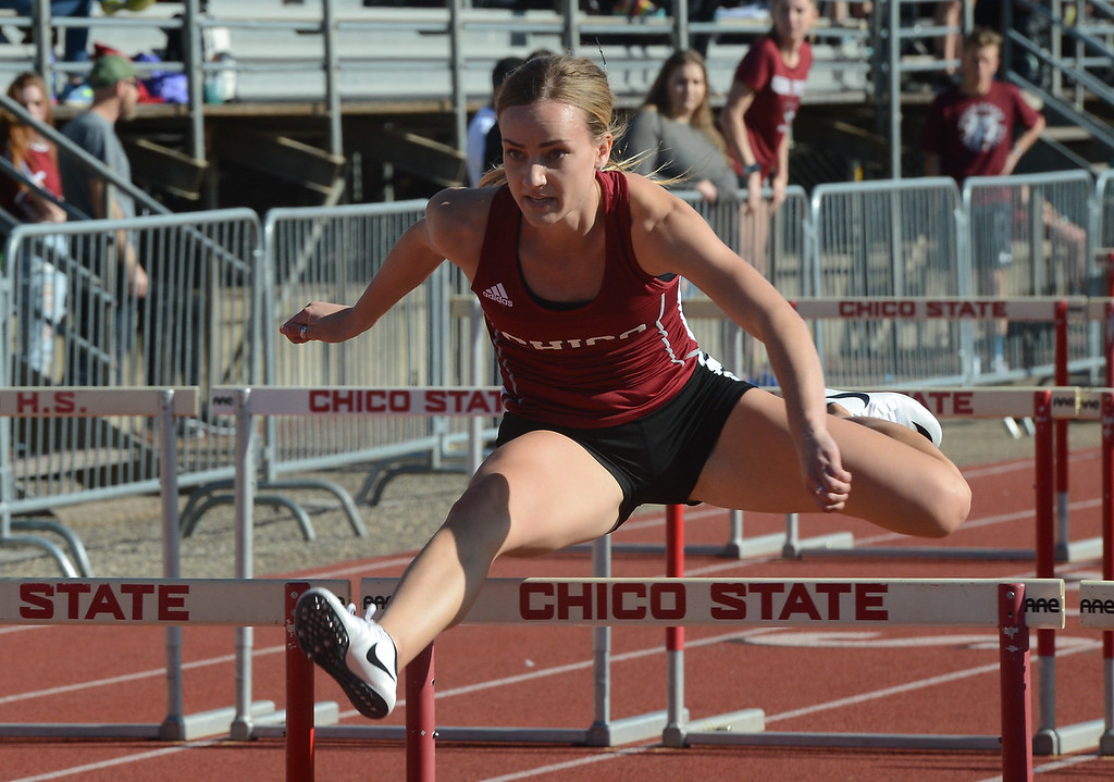 . Jenavieve Turner hurdles, Saturday, March 10, 2018, in Chico, California. (Carin Dorghalli -- Enterprise-Record)