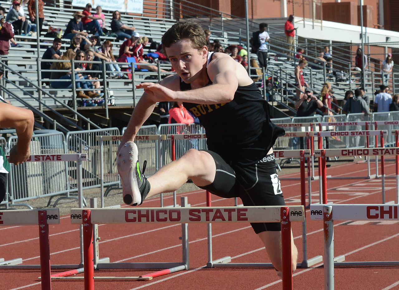 Kevin Schillig hurdles, Saturday, March 10, 2018, in Chico, California. (Carin Dorghalli -- Enterprise-Record)