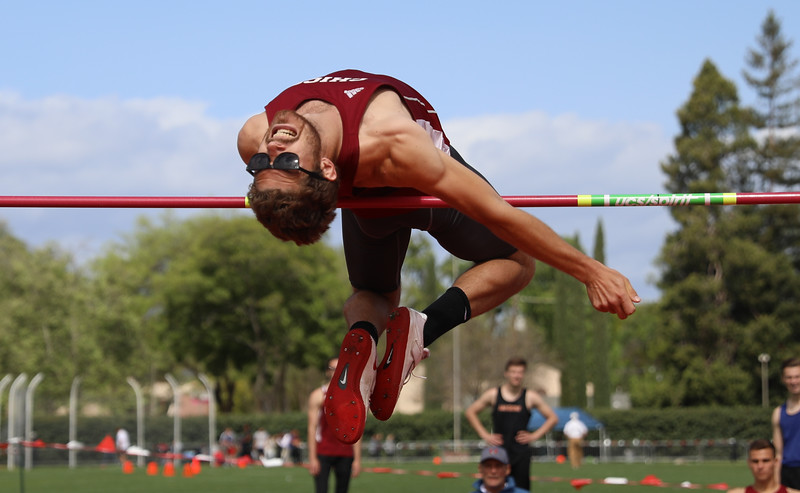 Chico State's Lane Andrews high jumps during the Twilight Invite, April 7, 2018, in Chico, California. (Carin Dorghalli -- Enterprise-Record)