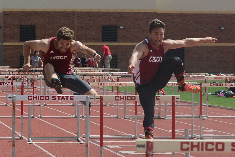 Chico State's Lane Andrews and Randall LeBlanc hurdle during the Twilight Invite, April 7, 2018, in Chico, California. (Carin Dorghalli -- Enterprise-Record)