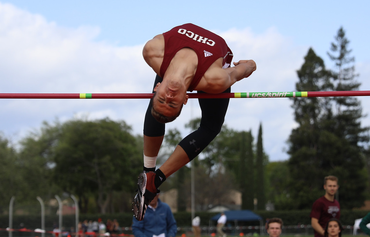 Chico State's Tyler Arroyo high jumps during the Twilight Invite, April 7, 2018, in Chico, California. (Carin Dorghalli -- Enterprise-Record)