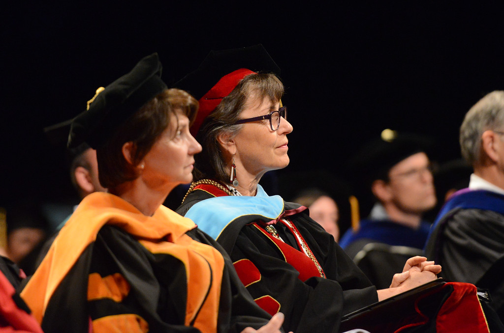 . Provost and vice president for academic affairs Dr. Debra Larson and president Gayle Hutchinson listen to speakers during the College of Agriculture Commencement Ceremony, May 18, 2018,  in Chico, California. (Carin Dorghalli -- Enterprise-Record)