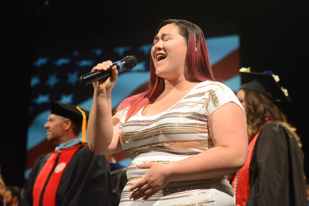 """. Elizabeth Quibell sings \""""The Star Spangled Banner\"""" during the College of Agriculture Commencement Ceremony, May 18, 2018,  in Chico, California. (Carin Dorghalli -- Enterprise-Record)"""