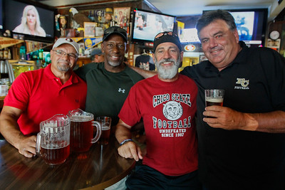 Chico State football  players and coaches from the 1960 to '90s gather for their annual reunion Thursday July 20, 2017 at the Oasis Bar & Grill in Chico, California.   (Emily Bertolino -- Enterprise-Record)
