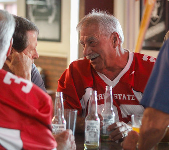 Chico State football  player Gerald Circo talks with teammates and other football players during the annual football reunion Thursday July 20, 2017 at the Oasis Bar & Grill in Chico, California.   (Emily Bertolino -- Enterprise-Record)