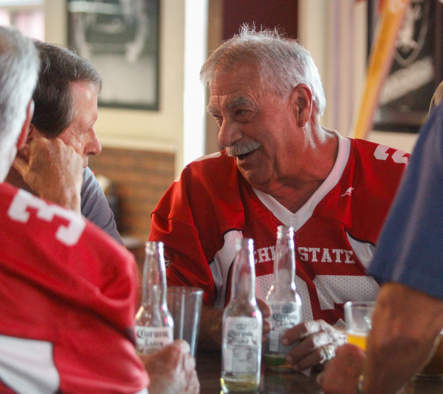 . Chico State football  player Gerald Circo talks with teammates and other football players during the annual football reunion Thursday July 20, 2017 at the Oasis Bar & Grill in Chico, California.   (Emily Bertolino -- Enterprise-Record)