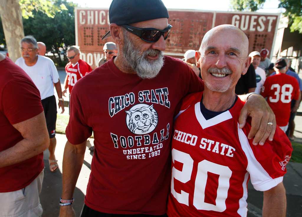 . Chico State football  players  Rod Robinson (1981-1982) and Dick Young (1962) talk during the annual football reunion Thursday July 20, 2017 at the Oasis Bar & Grill in Chico, California.   (Emily Bertolino -- Enterprise-Record)