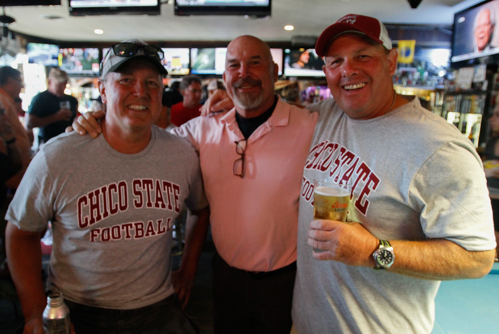 . Chico State football  players Rob Sciner (1989-1990), Jeff Nelson and Byron McLane who played 1982-1984 and went on to coach 1990-1993 during the annual football reunion Thursday July 20, 2017 at the Oasis Bar & Grill in Chico, California.   (Emily Bertolino -- Enterprise-Record)