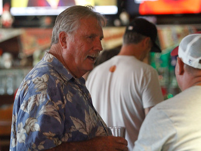 Chico State football coach Gary Houser (1979-1996) talks with players during the annual reunion Thursday July 20, 2017 at the Oasis Bar & Grill in Chico, California.   (Emily Bertolino -- Enterprise-Record)