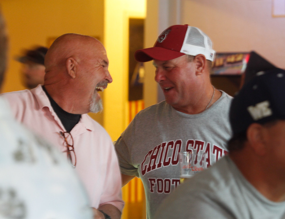 . Chico State football  players and coaches from the 1960 to \'90s gather for their annual reunion Thursday July 20, 2017 at the Oasis Bar & Grill in Chico, California.   (Emily Bertolino -- Enterprise-Record)