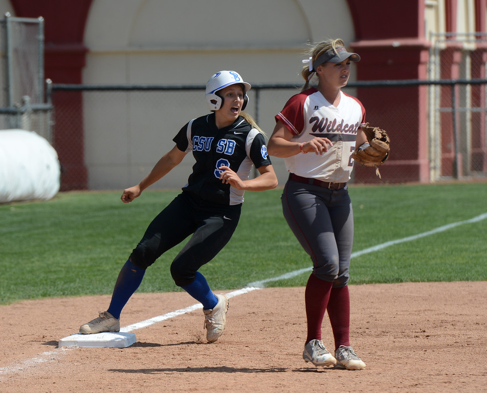 . Cal State San Bernardino\'s Morgan Ratliff sneaks in behind Chico State\'s Claire Wayne at third on the first day of the 2017 NCAA West Regional Division II Softball Championship Tournament Thursday May 11, 2017 at he University Softball Field in Chico, California. (Emily Bertolino -- Enterprise-Record)