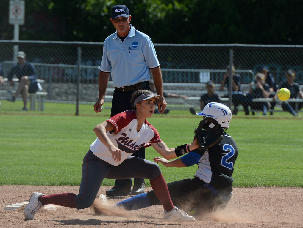 . Cal State San Bernardino\'s Jessica Brown slides in before Chico State\'s Kristin Worley can tag her out on the first day of the 2017 NCAA West Regional Division II Softball Championship Tournament Thursday May 11, 2017 at he University Softball Field in Chico, California. (Emily Bertolino -- Enterprise-Record)