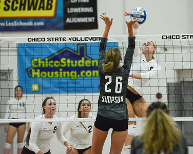 Chico State's Anna Baytosh spikes the ball past Simpson University's Jessilyn Ellenson Tuesday September 12, 2017 at CSUC in Chico, California. (Emily Bertolino -- Enterprise-Record)