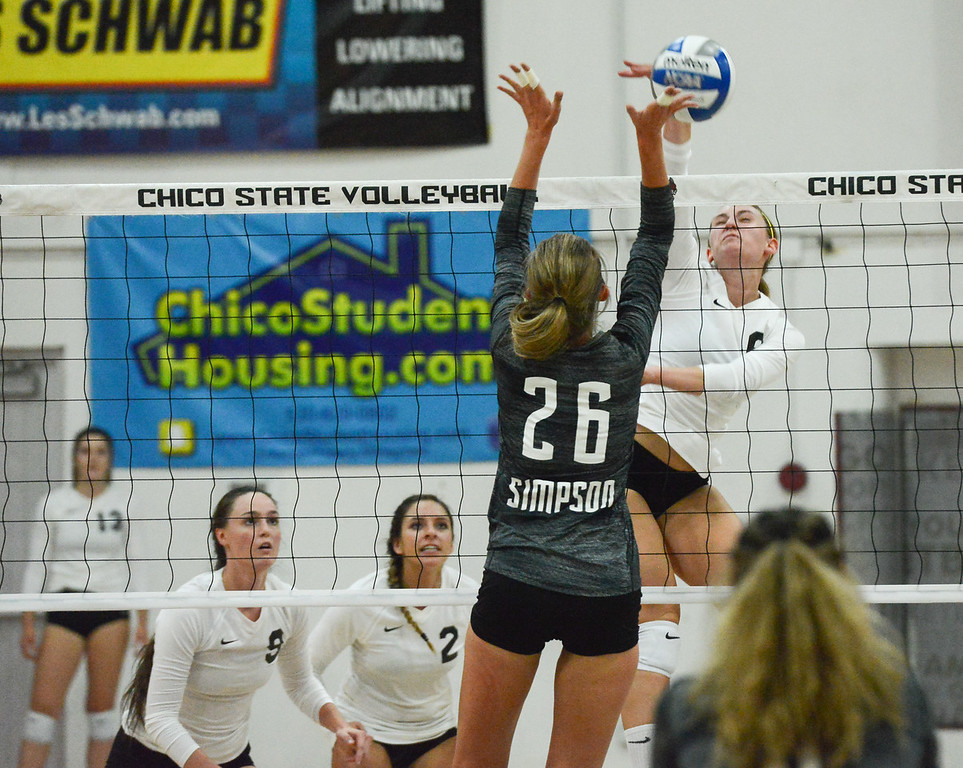 . Chico State\'s Anna Baytosh spikes the ball past Simpson University\'s Jessilyn Ellenson Tuesday September 12, 2017 at CSUC in Chico, California. (Emily Bertolino -- Enterprise-Record)