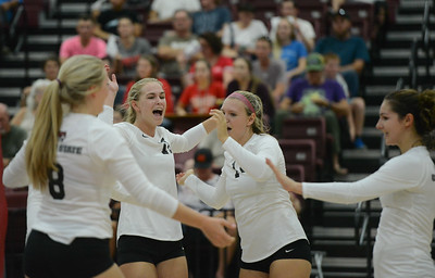 Chico State's Mckenna LaForge, Claire Wilson, McKenna Carroll and Brooke Fogel celebrate after a strong point won against Simpson University Tuesday September 12, 2017 at CSUC in Chico, California. (Emily Bertolino -- Enterprise-Record)