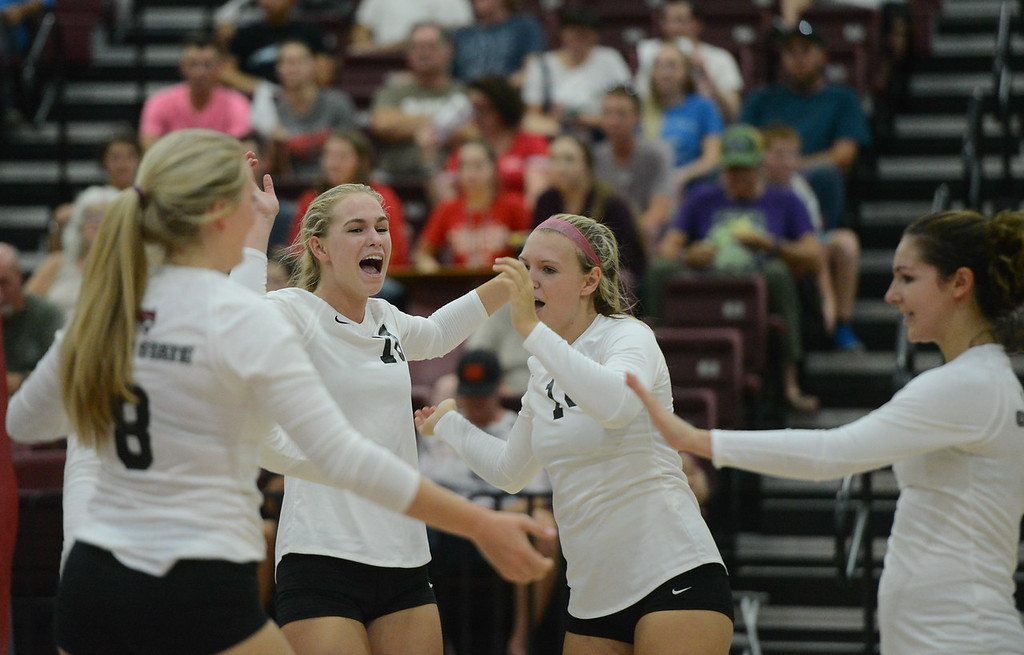 . Chico State\'s Mckenna LaForge, Claire Wilson, McKenna Carroll and Brooke Fogel celebrate after a strong point won against Simpson University Tuesday September 12, 2017 at CSUC in Chico, California. (Emily Bertolino -- Enterprise-Record)